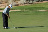 SCOTTSDALE, AZ - OCTOBER 21: George McNeill prepares putts in the Frys.com Open PGA golf tournament