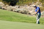 SCOTTSDALE, AZ - OCTOBER 22: Bubba Watson  chips onto the green in the Frys.com Open PGA golf tourna