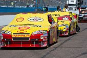 AVONDALE, AZ - APRIL 10: The #29 and #33  cars, driven by Kevin Harvick and Clint Boyer, await the s