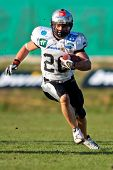 KORNEUBURG, AUSTRIA - April 4: Austrian Football League:  RB Florian Grein (#26, Raiders) scores two touchdowns against the Danube Dragons on April 4, 2009 in Korneuburg, Austria.