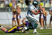 Vienna,  AUSTRIA - May 10: Austrian Football League:  WR Thomas Haider (#13, Dragons) and the Danube Dragons  beat the Vienna Vikings 24:27 on May 10, 2009 in Vienna, Austria.