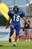 WOLFSBERG, AUSTRIA - AUGUST 16 American Football B-EC: Kicker Andrea Vergazzoli (#18, Italy) and his team beat Spain 42:7 on August 16, 2009 in Wolfsberg, Austria.