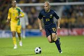 LONDON, UK AUGUST 19, Mark Bresciano running with the ball while playing in the international footba