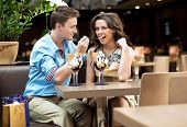 Young couple enjoying ice cream