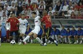 INNSBRUCK - JUNE 10: Marcos Senna of Spain (in red) & Konstantin Zyryanov of Russia (in white) durin