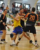 NAGYATAD, HUNGARY - APRIL 5: Peter Kovacs (with the ball) in action at Hungarian National Handball C