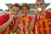 KAPOSVAR, HUNGARY - JULY 25: Bucuresti players show their medals at the V. Youth Football Festival U