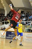 NAGYATAD, HUNGARY - FEBRUARY 5: Gyula Gal (with the ball) in action at Hungarian Cup Handball match