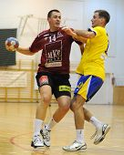 NAGYATAD, HUNGARY - FEBRUARY 5: Marko Vujin (L) holds the ball at Hungarian Cup Handball match (Nagy