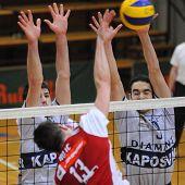 KAPOSVAR, HUNGARY - JANUARY 22: Skoric (L) and Nagy (R) blocks the ball at a Middle European League volleyball game Kaposvar (HUN) vs. HotVolleys Wien (AUT), January 22, 2010 in Kaposvar, Hungary.