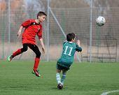 KAPOSVAR, HUNGARY - MARCH 21: Roland Vajda (R) in action at the Hungarian National Championship under 13 game between Kaposvari Rakoczi FC and Pecsi MFC March 21, 2010 in Kaposvar, Hungary.
