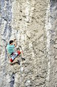 Young Man Climbing On A Limestone Wall With Wide Valley On The Background poster