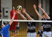 KAPOSVAR, HUNGARY - MARCH 22: Nemeth (C) and Csoma (R) block the ball at a Hungarian National Championship volleyball game Kaposvar vs. Veszprem, March 22, 2010 in Kaposvar, Hungary.