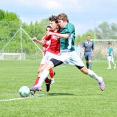 KAPOSVAR, HUNGARY - MAY 9: Milan Mayer (in green) in action at the Hungarian National Championship under 15 game between Kaposvari Rakoczi and Nagykanizsa May 9, 2010 in Kaposvar, Hungary.