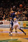 SZEKESFEHERVAR, HUNGARY - FEBRUARY 10: Roland Hendlein (in blue) in action at a Hugarian Champonship basketball game Albacomp vs. Kaposvar February 10, 2007 in Szekesfehervar, Hungary.