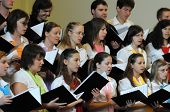 KAPOSVAR, HUNGARY - AUGUST 26: Members of the Liszt Ferenc Music School Choir sing at the IV. Pannon