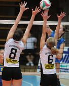 KAPOSVAR, HUNGARY - OCTOBER 10: Dora Kornyei (L) blocks the ball at the Hungarian NB I. League woman volleyball game Kaposvar vs Veszprem, October 10, 2010 in Kaposvar, Hungary.