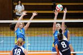 KAPOSVAR, HUNGARY - OCTOBER 31: Rebeka Rak (9) blocks the ball at the Hungarian NB I. League woman v