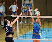 KAPOSVAR, HUNGARY - OCTOBER 31: Zsanett Pinter (R) blocks the ball at the Hungarian NB I. League woman volleyball game Kaposvar vs Ujbuda, October 31, 2010 in Kaposvar, Hungary.