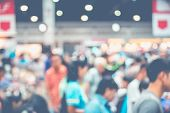 Blurred Background: Crowd Of People In Expo Fair With Bokeh Light ,vintage Filtered poster