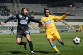 KAPOSVAR, HUNGARY - NOVEMBER 24: Krisztian Zahorecz (L) in action at a Hungarian Liga Cup soccer gam