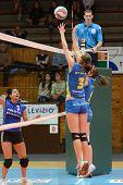 KAPOSVAR, HUNGARY - DECEMBER 19: Zsofia Harmath (3) blocks the ball at the Hungarian NB I. League wo