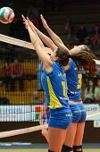 KAPOSVAR, HUNGARY - DECEMBER 19: Szandra Szombathelyi (L) blocks the ball at the Hungarian NB I. Lea