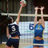 KAPOSVAR, HUNGARY - JANUARY 14: Marianna Palfy (R) blocks the ball at the Hungarian NB I. League woman volleyball game Kaposvar vs Ujbuda, January 14, 2011 in Kaposvar, Hungary.