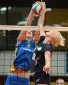 KAPOSVAR, HUNGARY - JANUARY 23: Petra Horvath (L) blocks the ball at the Hungarian NB I. League woma