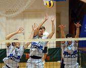 KAPOSVAR, HUNGARY - JANUARY 28: Krisztian Csoma (C) blocks the ball at a Middle European League voll