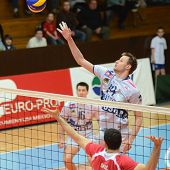 KAPOSVAR, HUNGARY - FEBRUARY 20: Krisztian Csoma (14) in action at a Middle European League volleyba