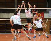 KAPOSVAR, HUNGARY - FEBRUARY 24: Krisztian Csoma (in black) strikes the ball at a Hungarian National