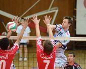 KAPOSVAR, HUNGARY - MARCH 18: Krisztian Csoma (R) strikes the ball at a Hungarian National Champions