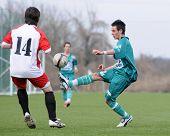 KAPOSVAR, HUNGARY - MARCH 13: Krisztian Varga (14) in action at the Hungarian National Championship