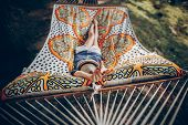 Smiling Blonde Hipster Woman Sleeping On A Hammock Outdoors, Beautiful Girl In Stylish Jean Clothing poster