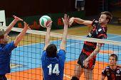 KAPOSVAR, HUNGARY - APRIL 3: Krisztian Csoma (R) strikes the ball at a Hungarian National Championsh