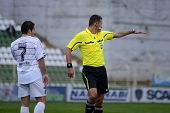KAPOSVAR, HUNGARY - APRIL 16: Ando-Szabo (referee) in action at a Hungarian National Championship so