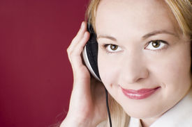 stock photo of lps  - Smiling woman listening to music - JPG