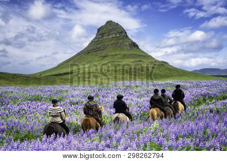 poster of Tourist Ride Horse At Kirkjufell Mountain Landscape And Waterfall In Iceland Summer. Kirjufell Is Th