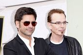 LOS ANGELES - FEB 6: John Stamos; Billy Bob Thornton at a ceremony where their rock band 'America' in honored with a star on the Hollywood Walk of Fame in Los Angeles, California. Feb 6, 2012