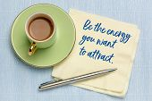 Be the energy you want to attract - handwriting on napkin with a cup of coffee, law of attraction co poster