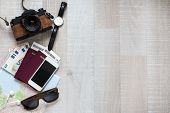 Travel Concept - Top View Of Travel Objects And Copy Space Over Wooden Table Background poster