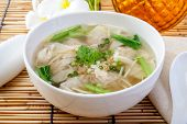 Soup With Dumplings, Wonton Soup On A Wooden Table poster