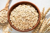 Oats, Oat Flakes Or Rolled Oats In A Bowl. Closeup View. Healthy Clean Eating Food, Healthy Lifestyl poster
