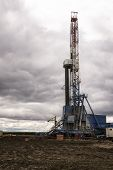 Oil Drilling Rig On The Field. Oil Field, Onshore Drilling Rig Around With Agriculture Field. View F poster