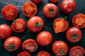 Top View Of Highly Detailed Red Tomatoes On Black Background Being Wet. Juicy Appetising Vegetables  poster