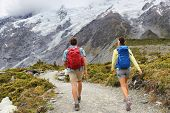 New Zealand travel tramping hikers walking on trail of Hooker Valley Track in New Zealand Aoraki/Mt  poster