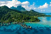 Bora Bora aerial drone video of travel vacation paradise with overwater bungalows luxury resort, cor poster