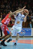KAPOSVAR, HUNGARY - JANUARY 28: Nik Raivio (in white) in action at a Hungarian Championship basketba