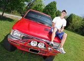 Teen On Truck Hood